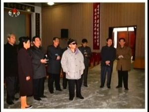 Kim Jong-il looking at production statistics at the Unhung Cooperative Farm. Jang Song-thaek and Ri Je-gang are on the left, looking like two old people gossiping in church. (Photo: KCNA)