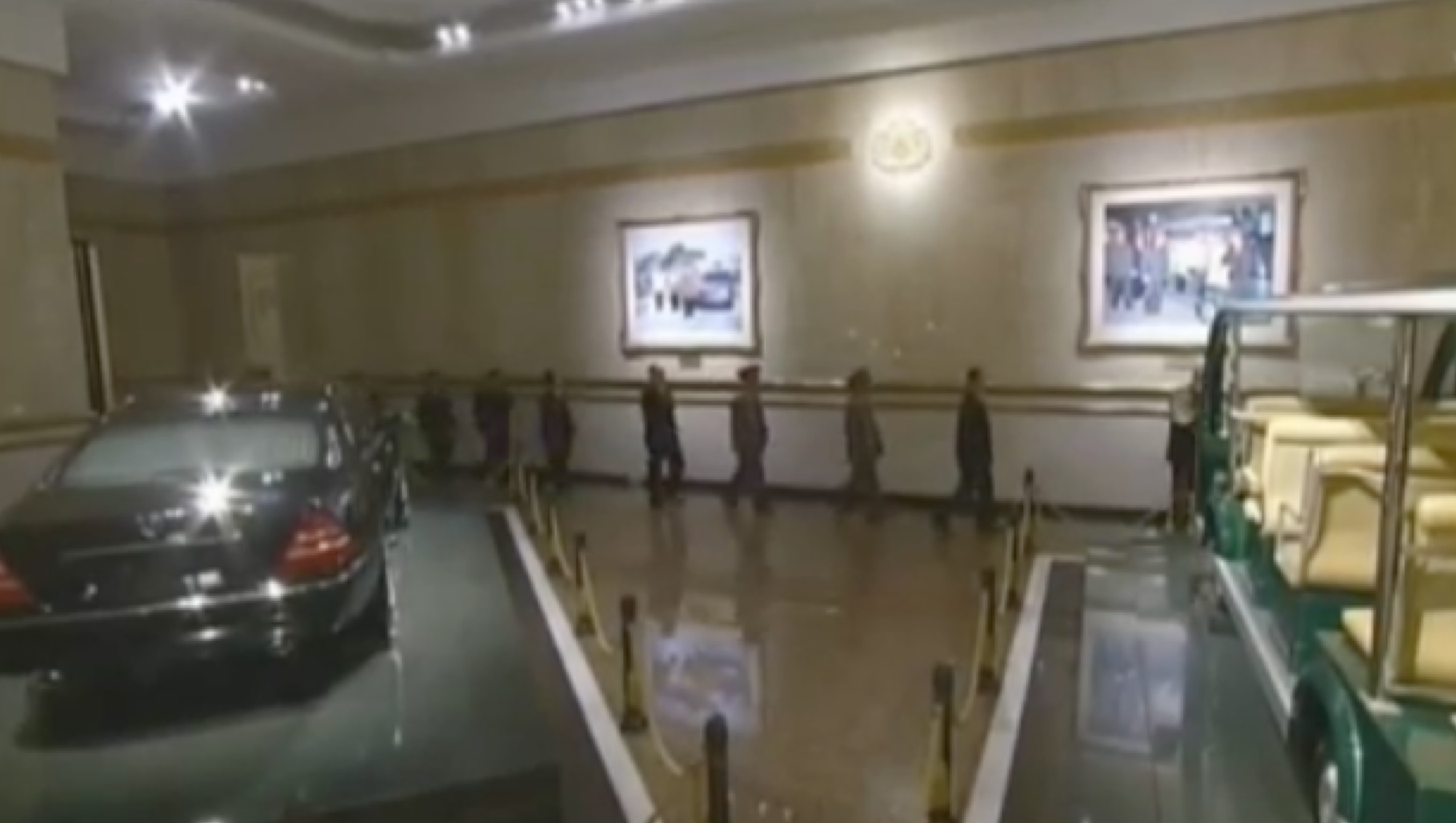 Senior DPRK officials walk past displays of Kim Jong Il's personal car and electric mobility cart on February 16, 2017 at Ku'msusan Palace of the Sun in Pyongyang (Photo: Korean Central Television).