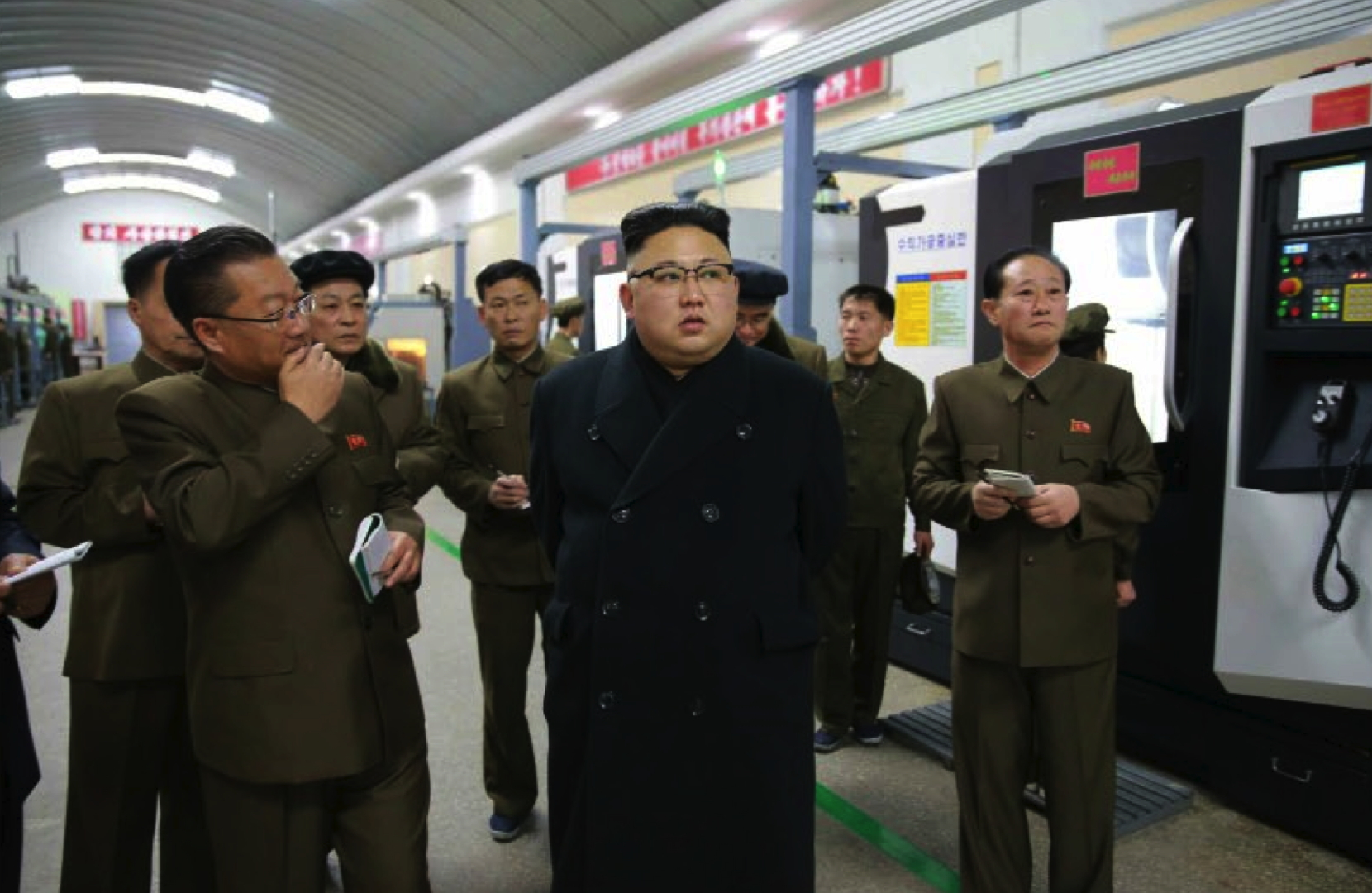 Kim Jong Un is briefed about production at the Kangdong Precision Machine Plant in the suburbs of Pyongyang in a photo which appeared top-center on the front page of the February 7, 2017 edition of WPK daily organ Rodong Sinmun (Photo: Rodong Sinmun).